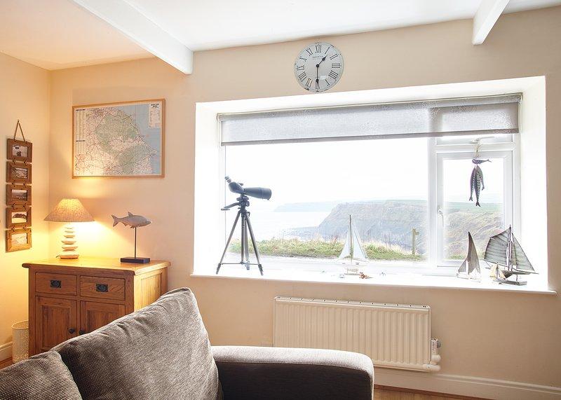 vista para o mar da sala de estar