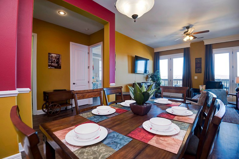 Ozark Hilltop condo dining room for 6 people.  There are 2 extra seating at the bar in the kitchen