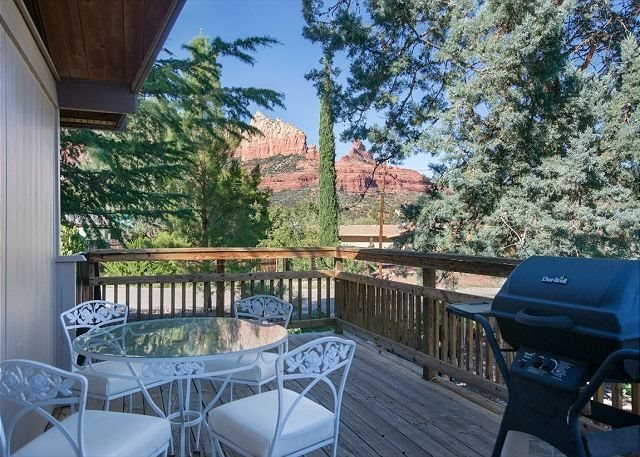 view of Wilson Mountain from wrap around deck featuring outdoor dining and BBQ grill