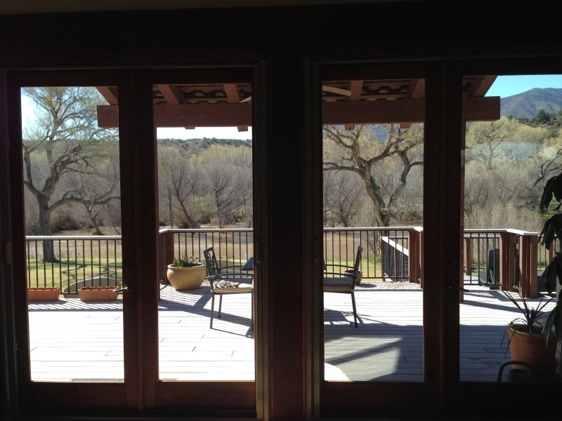 view of back patio from great room towards river
