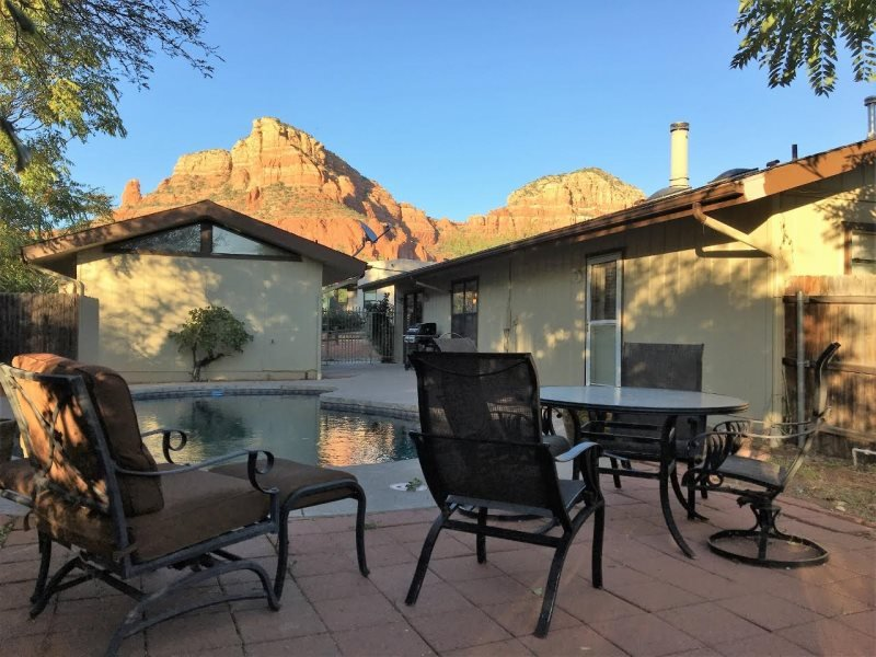 Outdoor seating area, pool and view of Saddleback Mountain