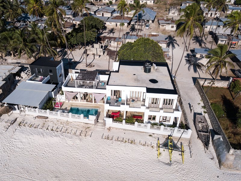 Aerial view. The house is directly located on the beach and in the village