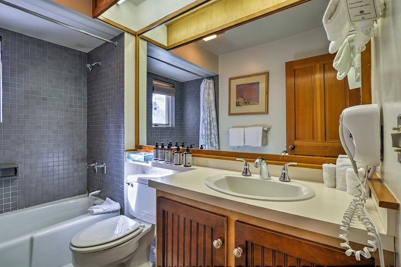 This full bathroom offers a tub/shower combo.