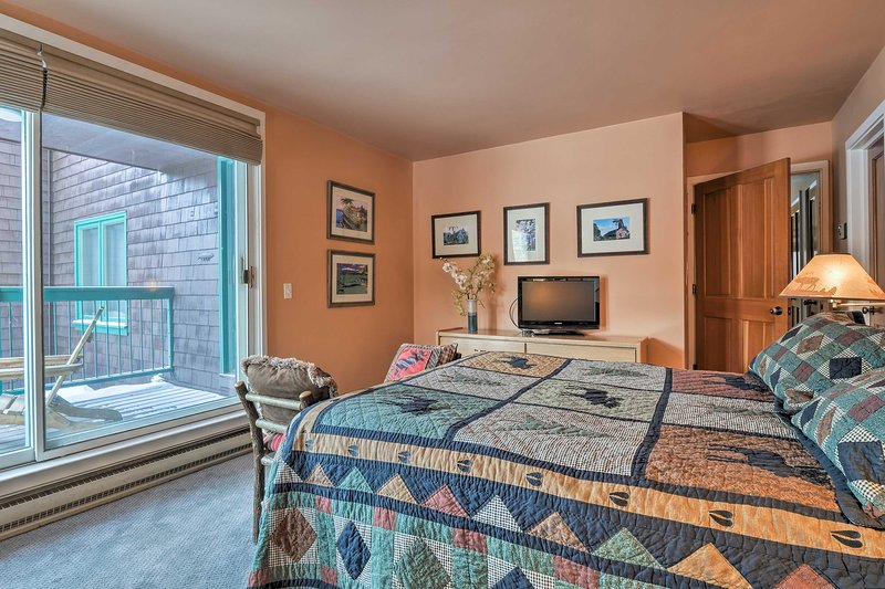 After a long day of skiing, seek comfort in the master bedroom.