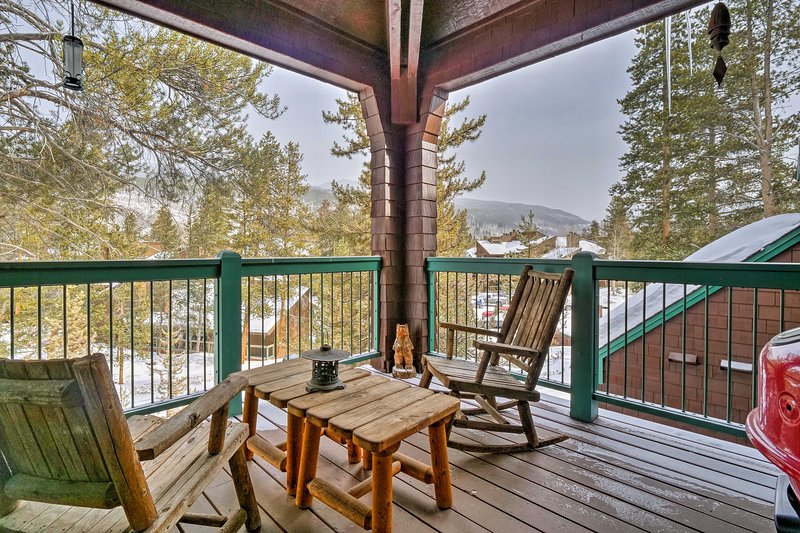 Look out to snow-capped peaks and tree-lined scenery from your private deck.