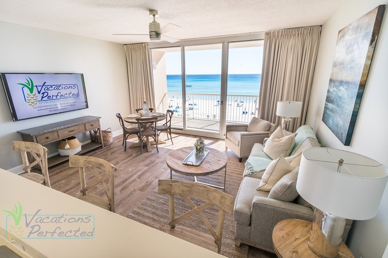This living room has spectacular view looking out unto the Gulf of Mexico right from this living room space.