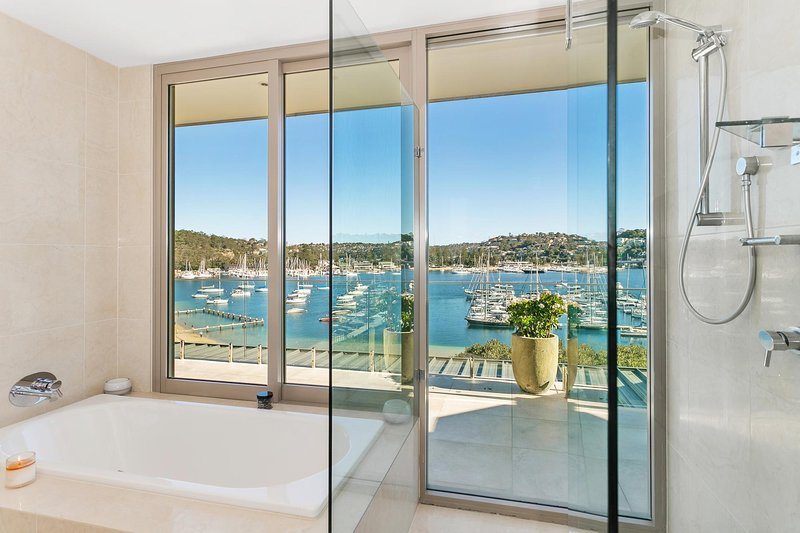 Bathroom with harbour views