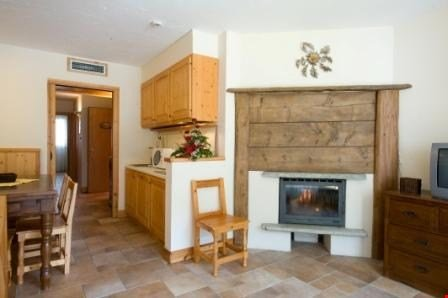 Return to the cosy 375 sq. ft. studio apartment, which features beautiful wooden decor and modern amenities.