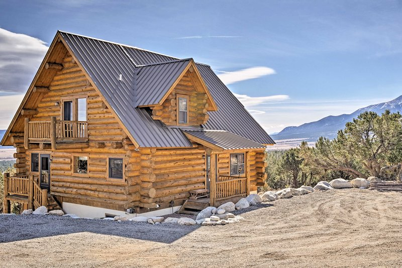 The mountains are calling for you to stay at this beautiful log cabin!