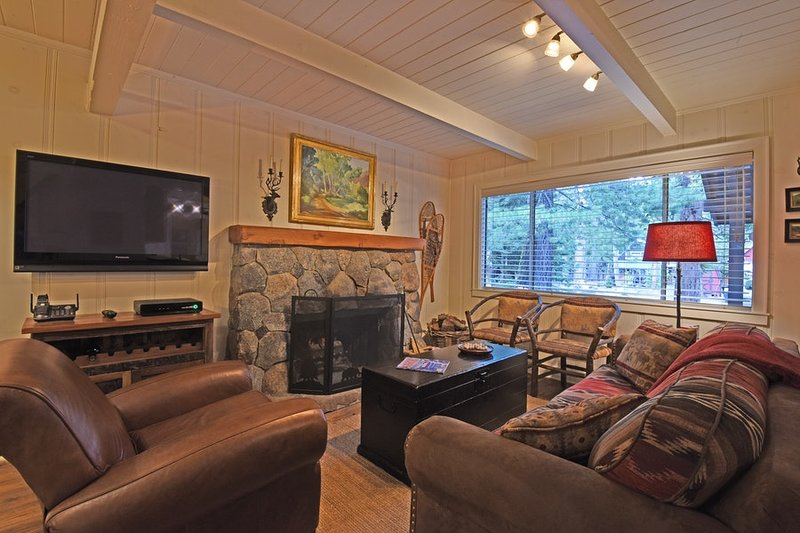 Cozy family room with a stone hearth and flat screen TV