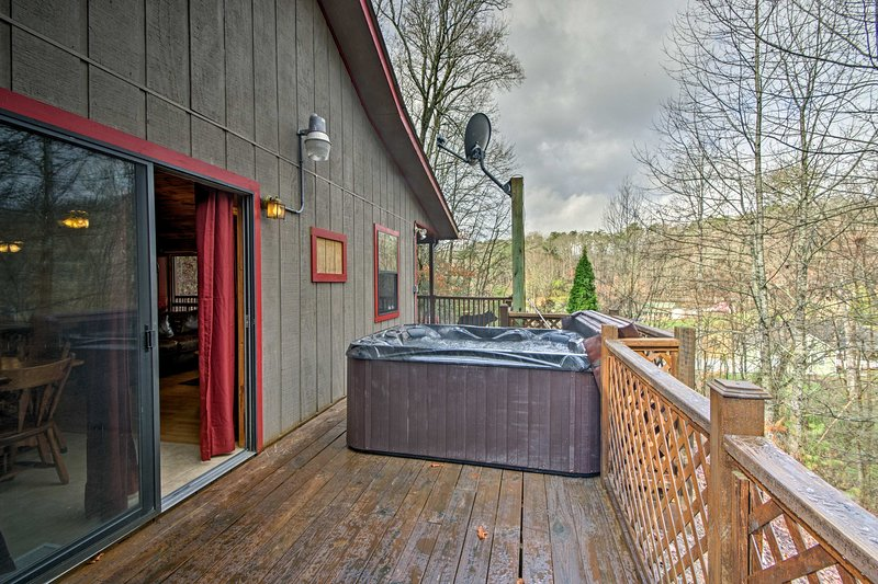 Enjoy a private hot tub after mountain adventures.
