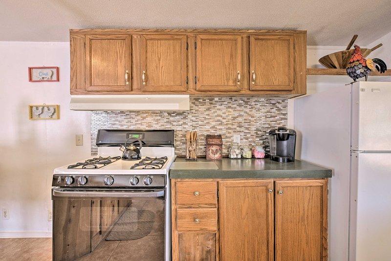 The kitchen is both quaint and convenient.