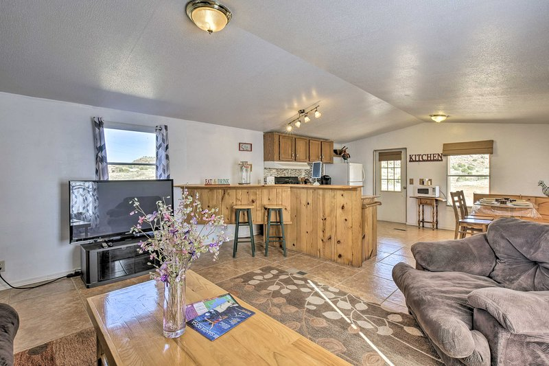 With beds for 4 and space for 5, this home is perfect for families.