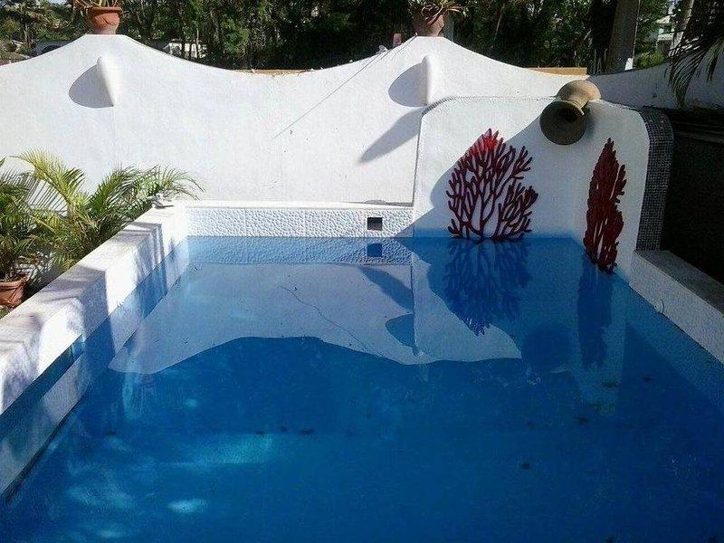 Amazing house with shared pool, aluguéis de temporada em Boca Chica