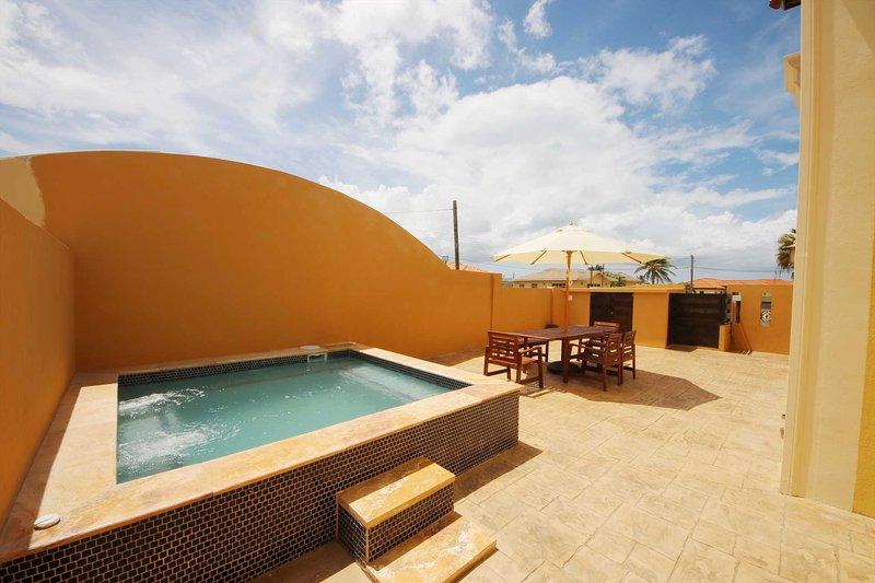 Your Coastal Casual Two-bedroom condo outdoor delight!