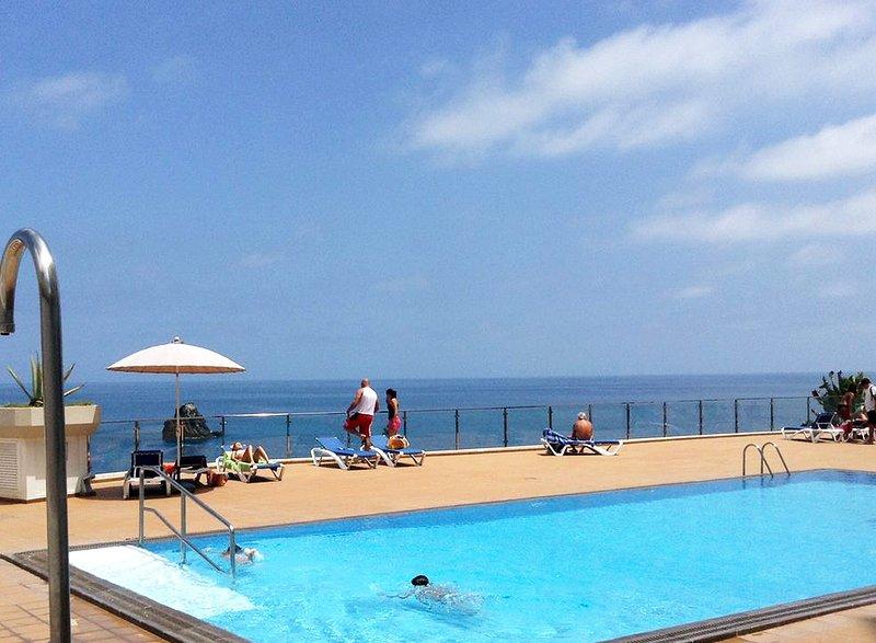 Condominium swimming pool by the Lido sea promenade