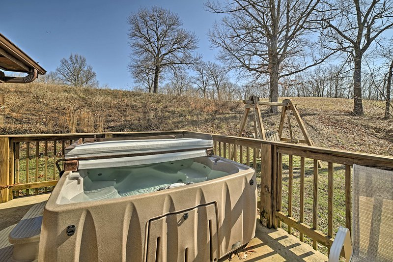 Up to 9 travelers will love the private hot tub on the spacious furnished deck.