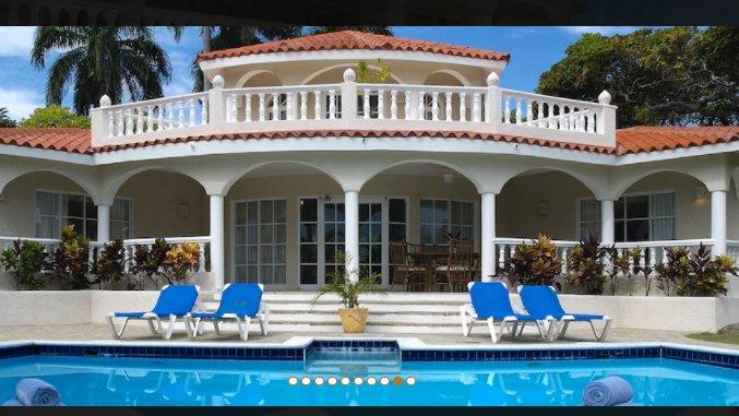 Backyard view of beautiful villa with pool!