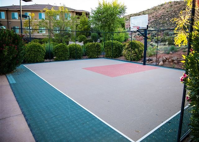 Basketball court for play and exercise. Equipment available upon