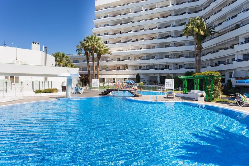 Large communal heated pool and apartments.