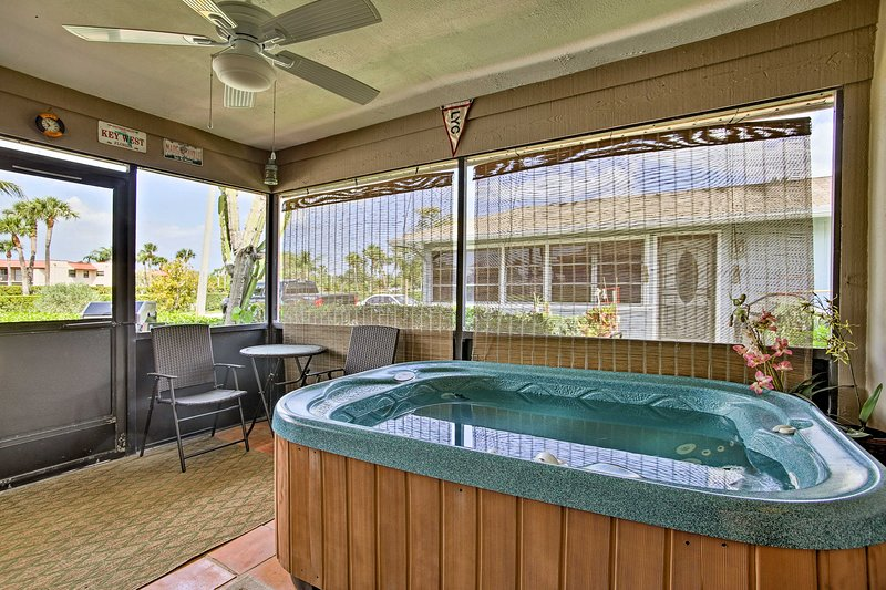 This Jensen Beach vacation rental villa boasts a private porch and hot tub.