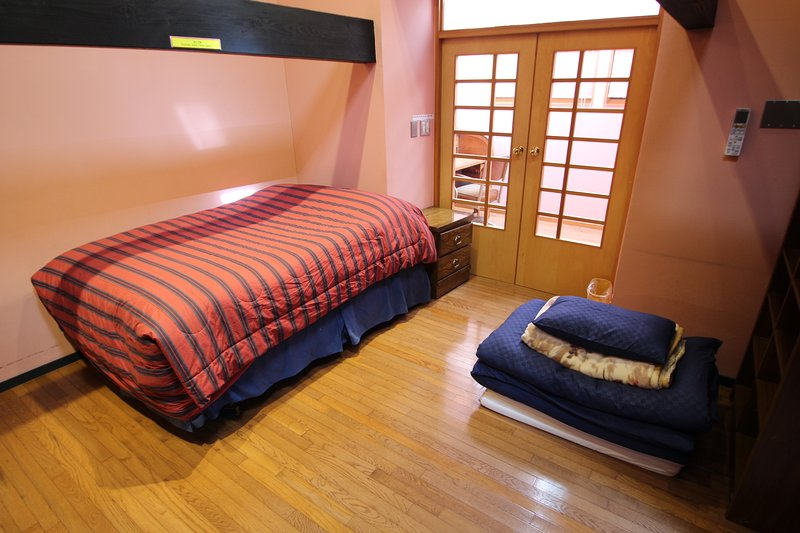 Double bed and futon available for 3 guests.