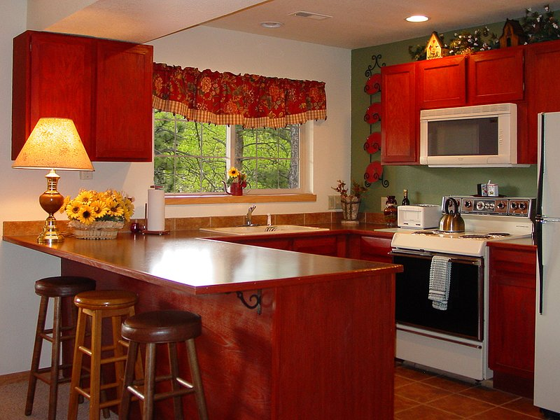 Cozinha totalmente equipada, incluindo máquina de lavar / secar roupa