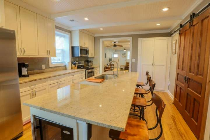 Kick back & relax in this beautifully renovated kitchen with stainless steel appliances, hardwood floors & granite countertops.
