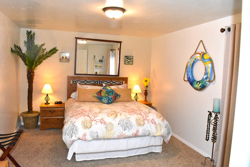 This is the Hawaii Room. Very Spacious with big walk in closets and very nice queen bed comfy sheets