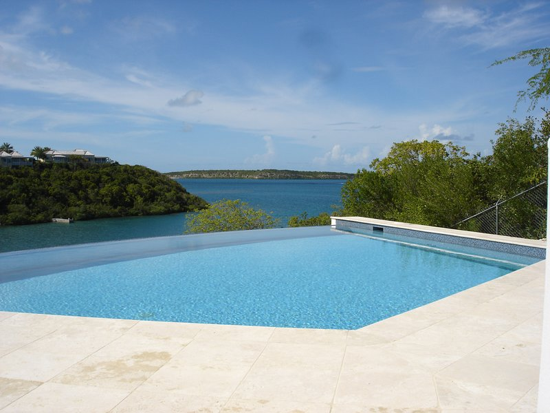 Infinity edge pool,40 feet across, with extensive sundeck and sea views.