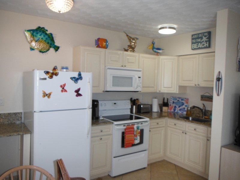 Full Kitchen with Microwave, Kcup Coffee Machine, Dishes, Pots & Pans, Silverware.