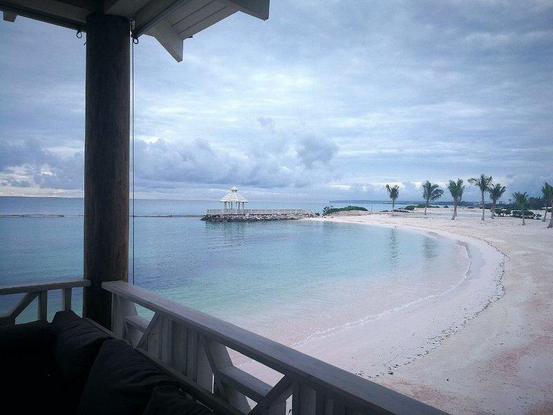 Take a drink at the terrace of our beach club, Api Beach