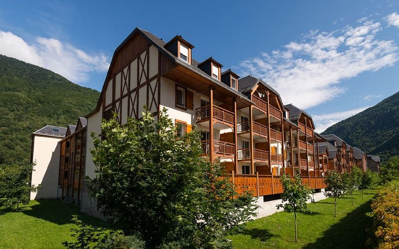 exterior of the apartment block and lovely mountain views