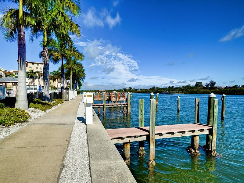 Walk along the water at the Barefoot Beach Condo.