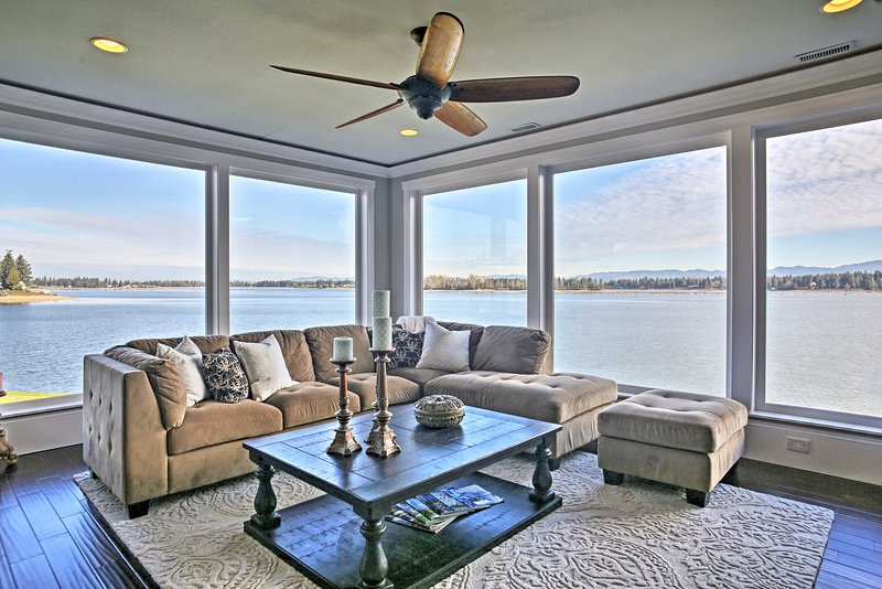 Panoramic views of Lake Tapps await at this 3-bedroom, 2-bathroom vacation rental home!