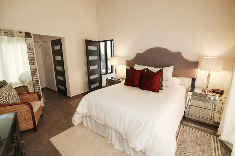 Second bedroom has a queen size bed, private bathroom, and ocean view balcony.