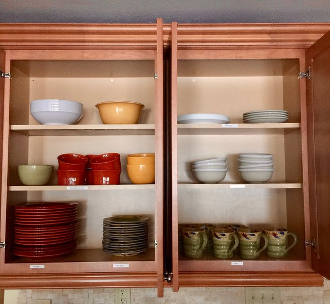 Plenty of plates and bowls for 10-12 people