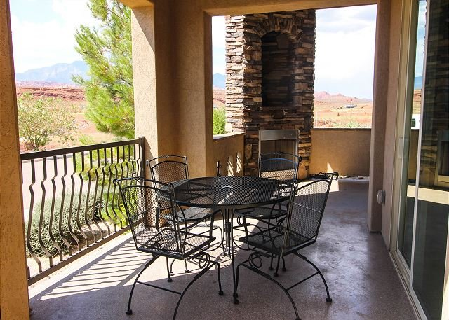 Private patio with dining area, gas fireplace, and personal BBQ