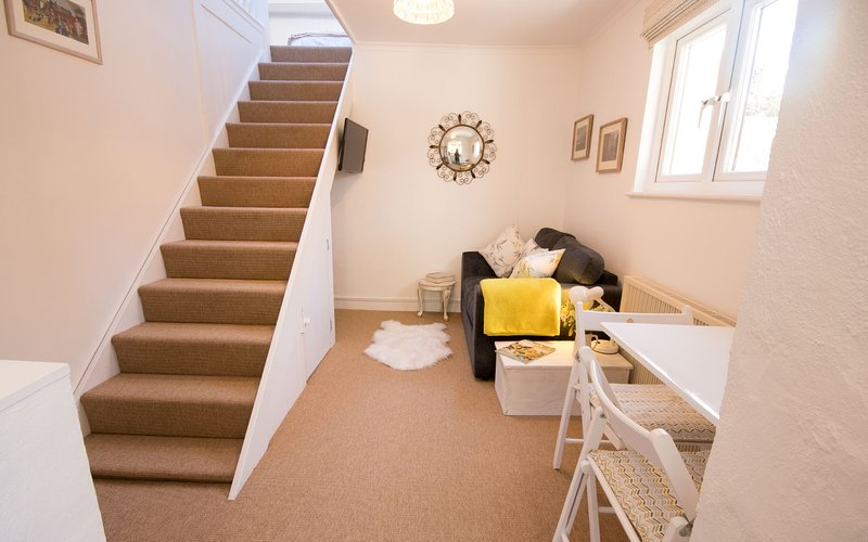 Lower Crofty lounge and stairs to double bedroom