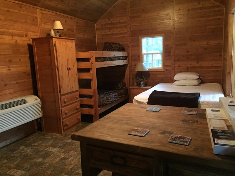 one queen bed and twin bunk beds