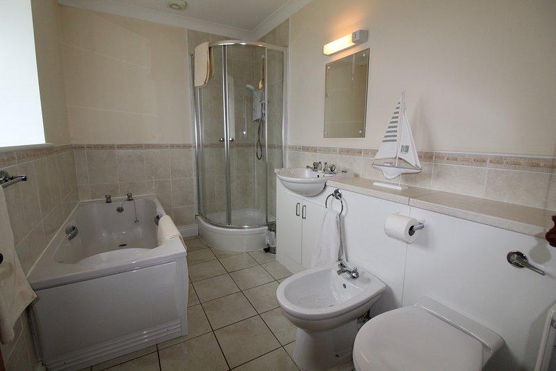 Jacobswell Casa Dormitorio principal con baño
