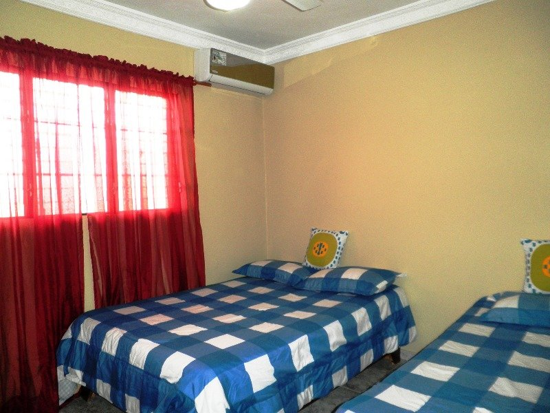 Air conditioned Bedroom  with Private bathroom 1 double and one single beds