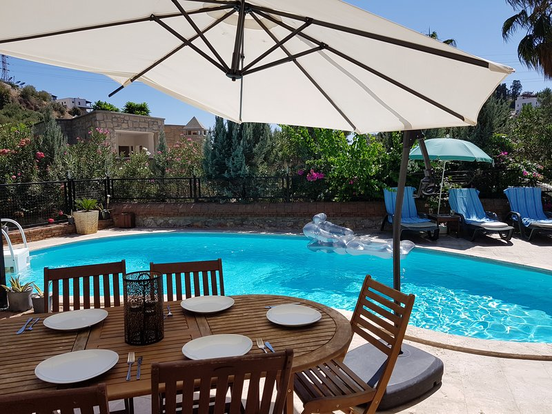 Dine alfresco next to your private pool
