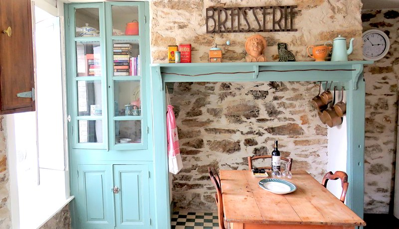 The kitchen with door opening onto the the sunny terrace