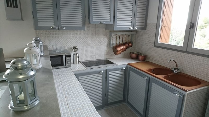fitted kitchen microwave ceramic hob, fridge.