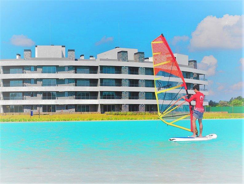 Departamento con Jardin Y PLAYA PRIVADA , VISTA CARIBE Lagoon Pilar, location de vacances à Campana