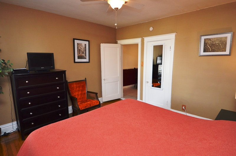 Bedroom With King Sized Bed and 20' TV