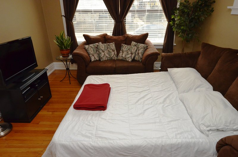 Living Room With Pull Out Bed and 32' TV