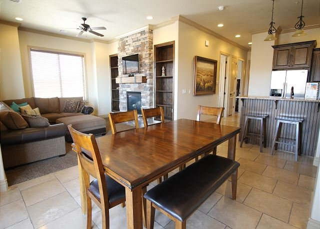 Dining room opens onto patio, living area, and kitchen