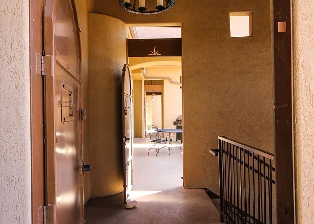 Private entrance from garage stairwell